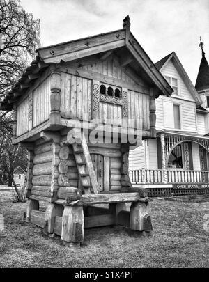 Traditional Scandinavian stabbur next to Victorian Home, Mount Horeb, WI - Stock Photo