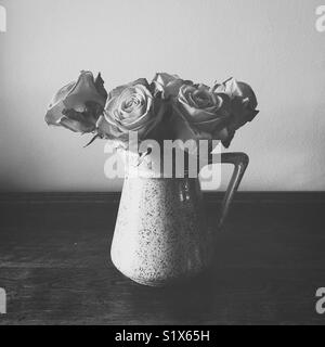 Roses in a pitcher in black and white - Stock Photo