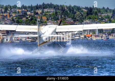 Floatplane taking off of Lake Union in Seattle Washington - Stock Photo