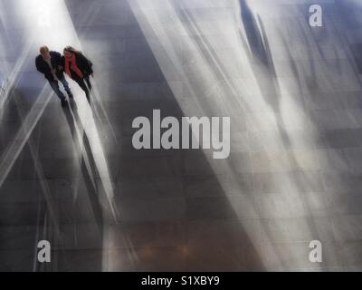Couple walking through Mall, New York City, USA - Stock Photo