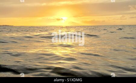 Sunset over still waters - Stock Photo