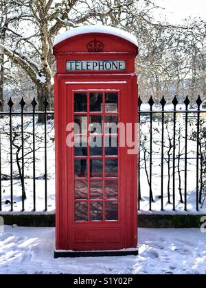 London telephone box in the snow - Stock Photo