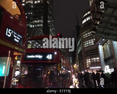buses, cars and people on a busy street in London - Stock Photo