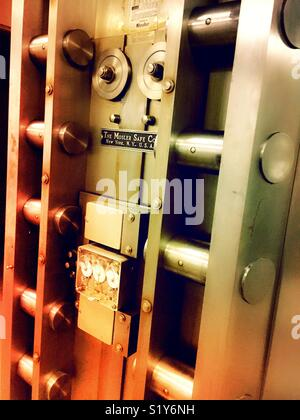 Vault locking mechanism on the inside of a large safe door, USA - Stock Photo