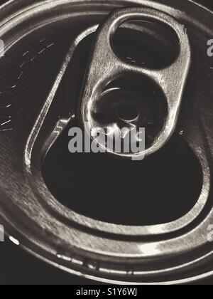 Closeup view of opened aluminum soda pop can top in black and white - Stock Photo