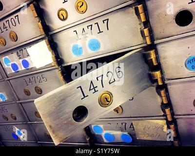 And open safe deposit box in secure vault area in a bank, USA - Stock Photo
