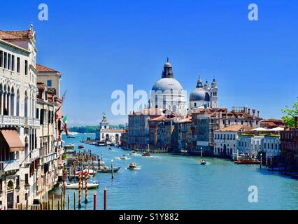 View of the Grand Canal and Santa Maria Della Salute from the Academia Bridge - Stock Photo