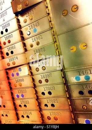 Bank safe deposit boxes in a secure vault area in a bank, USA - Stock Photo
