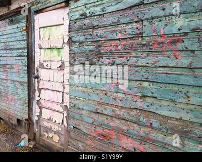 Decrepit wall and door - Stock Photo