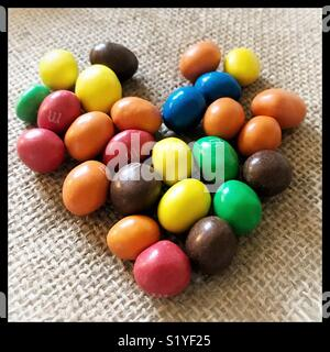 Sweets in the shape of a heart on hessian