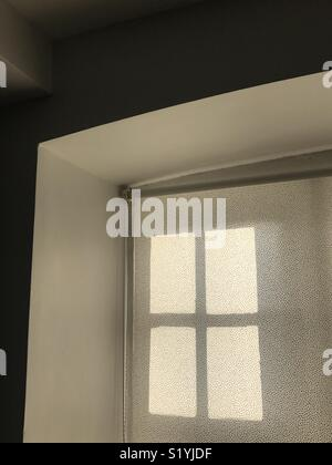 Sunlight coming through a window and blind - Stock Photo