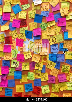 Wall with colorful sticky notes - Stock Photo