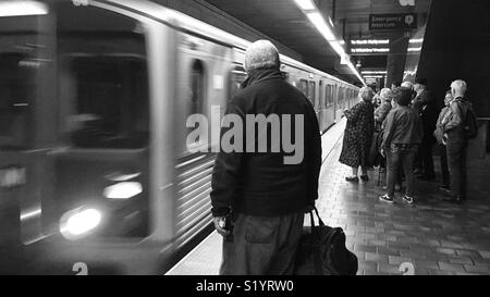 Passengers wait on platform as LA Metro subway trains pulls into station at 7th Street Metro Center in Downtown Los Angeles - Stock Photo