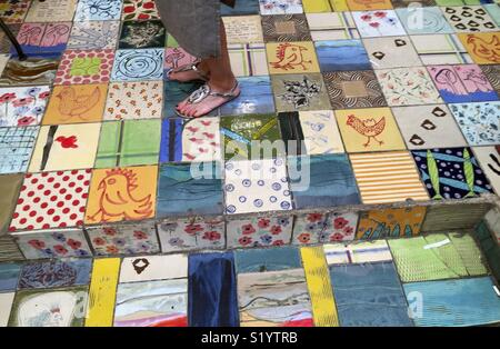 Tile Art with differnt colors and designs on a market in Israel