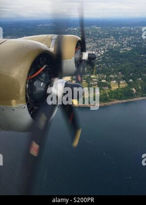 Close up of B-17 engines on a flight around Seattle, Washington. - Stock Photo