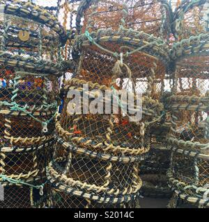 Crab nets stacked near the harbour in Torquay, Devon - Stock Photo
