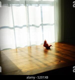 An origami swan. - Stock Photo