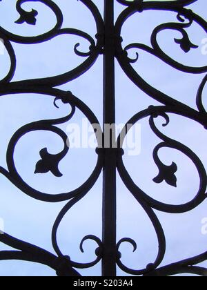 Filigree pattern at a historic gate of iron - Stock Photo