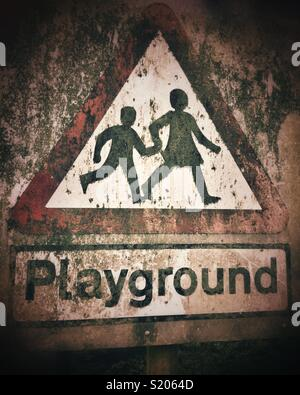 Mouldy old Playground sign - Stock Photo