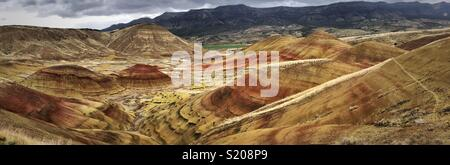 Panoramic view of Painted Hills, in the northwest United States, one of the three units of the John Day Fossil Beds National Monument, located in Wheeler County, Oregon - Stock Photo