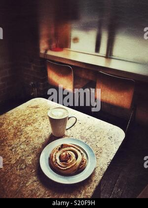 A pastry and early morning coffee - Stock Photo