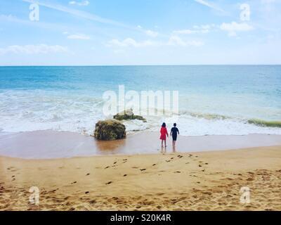 Two children on Beach - Stock Photo