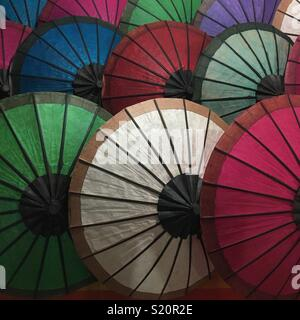 Parasols in market stall in Luang Prabang Laos - Stock Photo