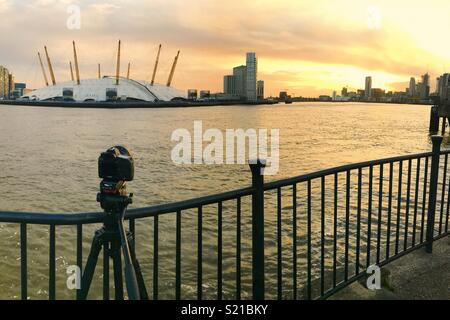 Timelapse camera filming a sunset over the o2 Arena in London - Stock Photo