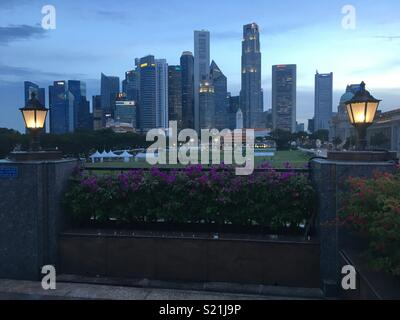 Singapore business district skyline taken from the Singapore Recreation Club. - Stock Photo