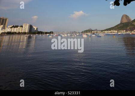 Wide angle view of the water and boats in Rio De Janeiro with Copagabana beach and Sugar Loaf Mountain - Stock Photo