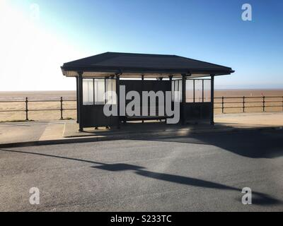 Wooden shelter on a promenade at the seaside, Hoylake, Wirral - Stock Photo