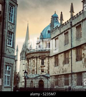 Radcliffe Camera and University Church in Oxford at Sunset - Stock Photo