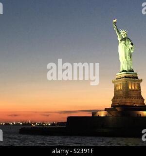 Statue of Liberty Sunset - Stock Photo