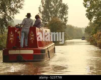 A couple on holiday on a narrowboat - Stock Photo
