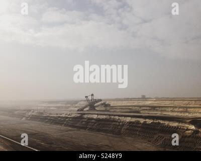 Bucket wheel excavator in open cast pit - Stock Photo