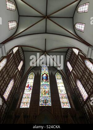Interior stained glass windows & ceiling- St Josephs Cathedral, Hanoi, Vietnam - Stock Photo
