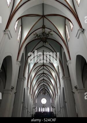 Interior ceiling & stained glass windows-St Josephs Cathedral, Hanoi, Vietnam - Stock Photo