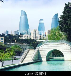 The Flame Towers as seen from the Mini Venice area of the Baku Boulevard, Baku, Azerbaijan - Stock Photo