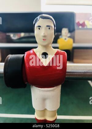 Close up of footballer figurine on table football - Stock Photo