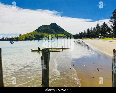 Pilot Bay, with Mt. Mounganui, or Mauao, or The Mount, in the Background, with Old Jetty Piles in Foreground, North Island, New Zealand, Oceania - Stock Photo