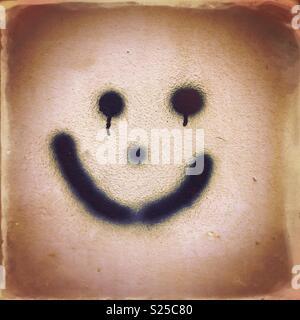 Smiley face graffiti - Stock Photo