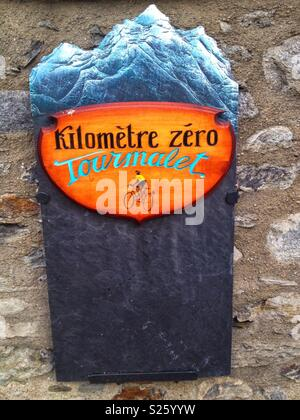 Plate indicating the start of the ascent of the Col du Tourmalet by bike, Luz St Sauveur, Occitanie France - Stock Photo