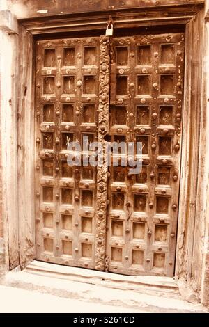 Swahili carved wooden door in Lamu, Kenya - Stock Photo