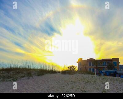 Sunrise over dunes and sand at the beach - Stock Photo