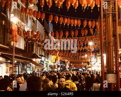 Chinese New year in China town London with hanging lanterns - Stock Photo