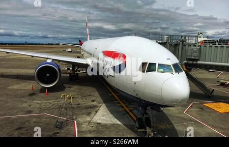 Boeing 777 jet operated by British Airways at Seattle-Tacoma Airport - Stock Photo
