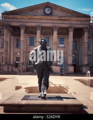 Statue of Sir Harold Wilson PM outside Huddersfield Railway station England - Stock Photo
