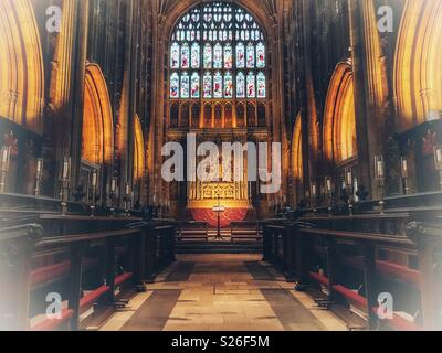 Altar, choir stalls, stained glass window, in the magnificent Sherborne Abbey, Sherborne, Dorset, England - Stock Photo