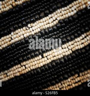 Black and white seed beads. - Stock Photo