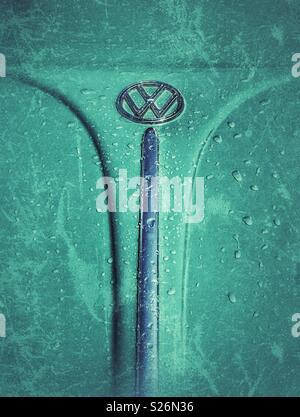 Wet vintage VW Beetle hood with grunge texture - Stock Photo